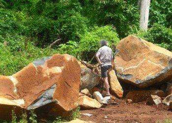sculptor prepares rock