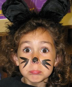 Young girl in cat costume